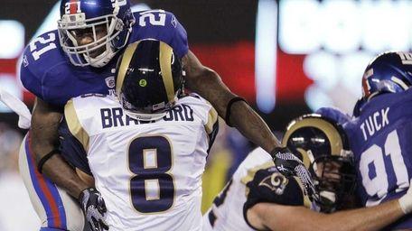 St. Louis Rams quarterback Sam Bradford is hit
