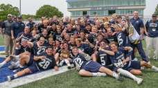 Massapequa players and coaches celebrate their victory over