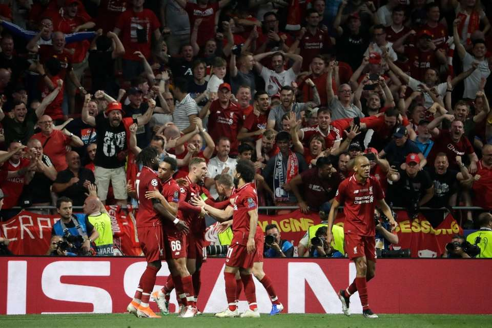 Liverpool's Divock Origi, left, celebrates with his teammates