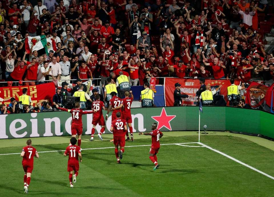 Liverpool forward Divock Origi celebrates with teammates after