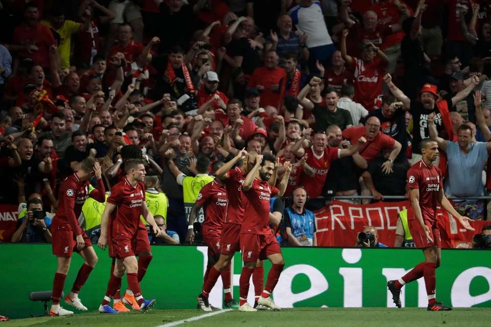 Liverpool's players celebrates with their teammate Divock Origi