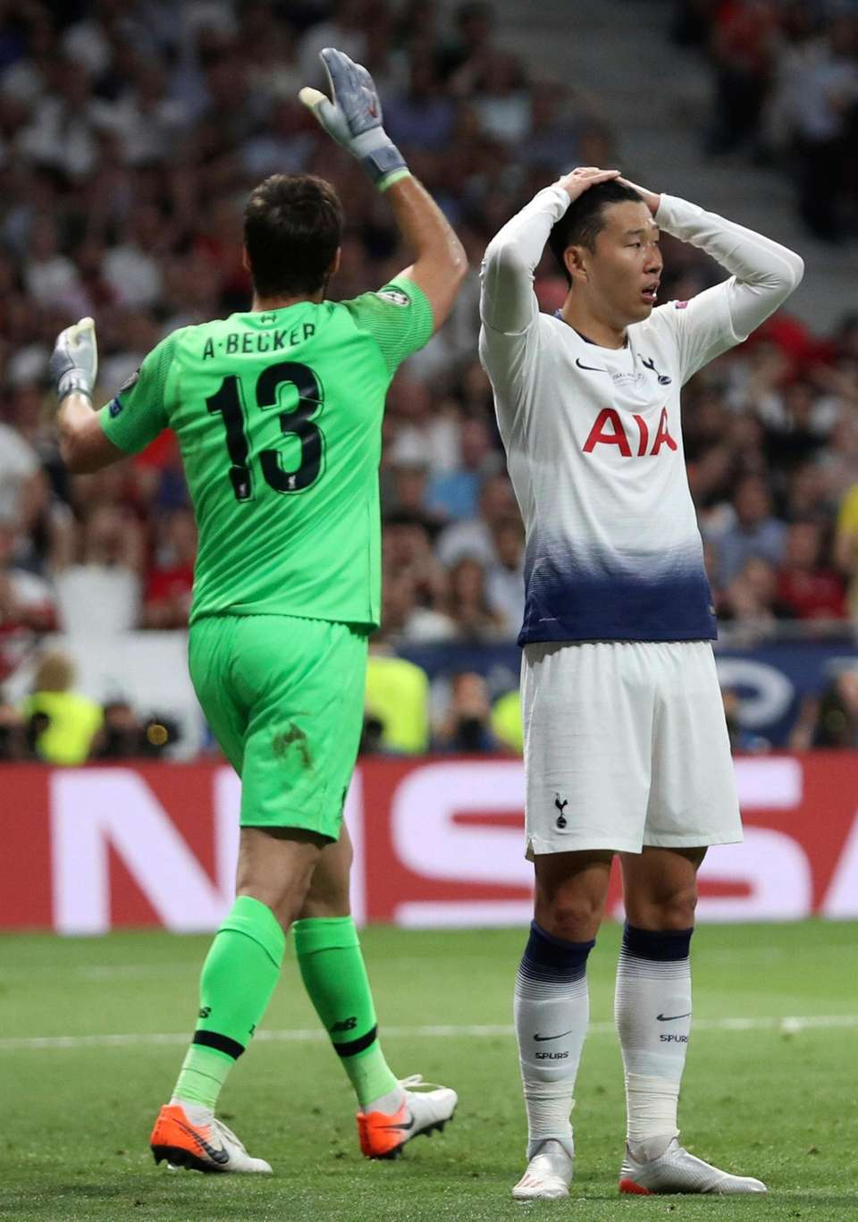 Tottenham's Son Heung-min, right, holds his head after
