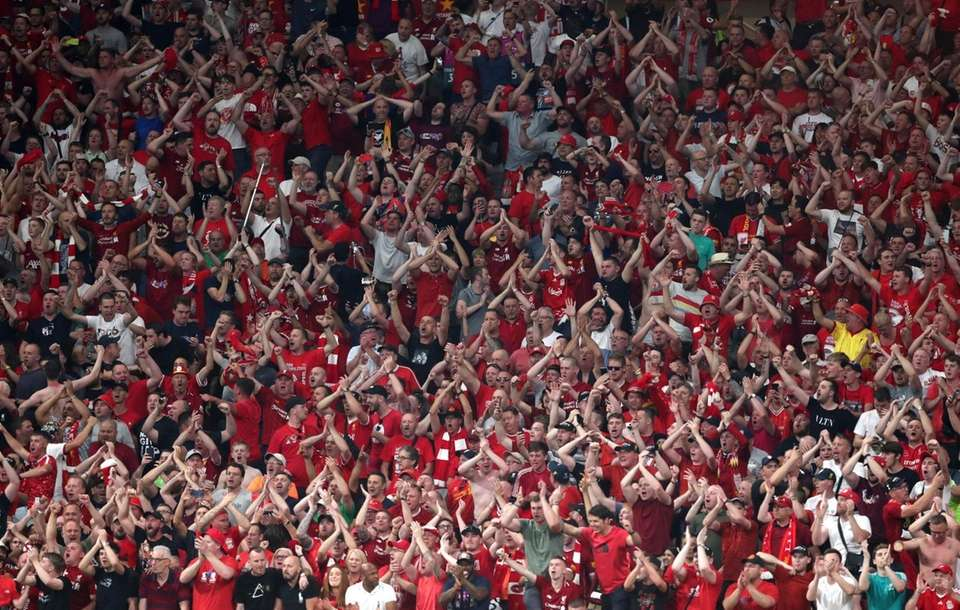Fans of Liverpool celebrate their sides second goal