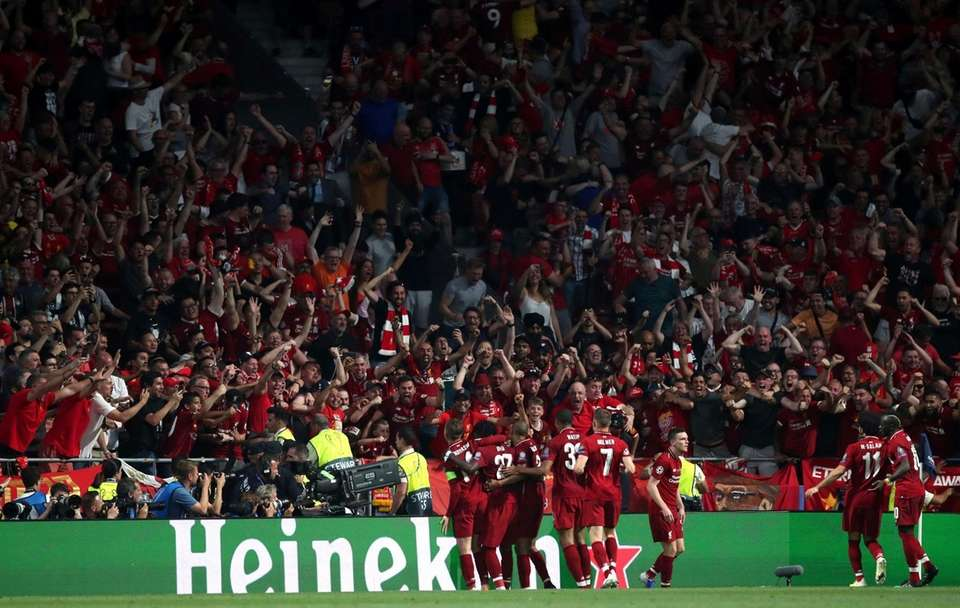 Liverpool's Divock Origi celebrates with his fans and