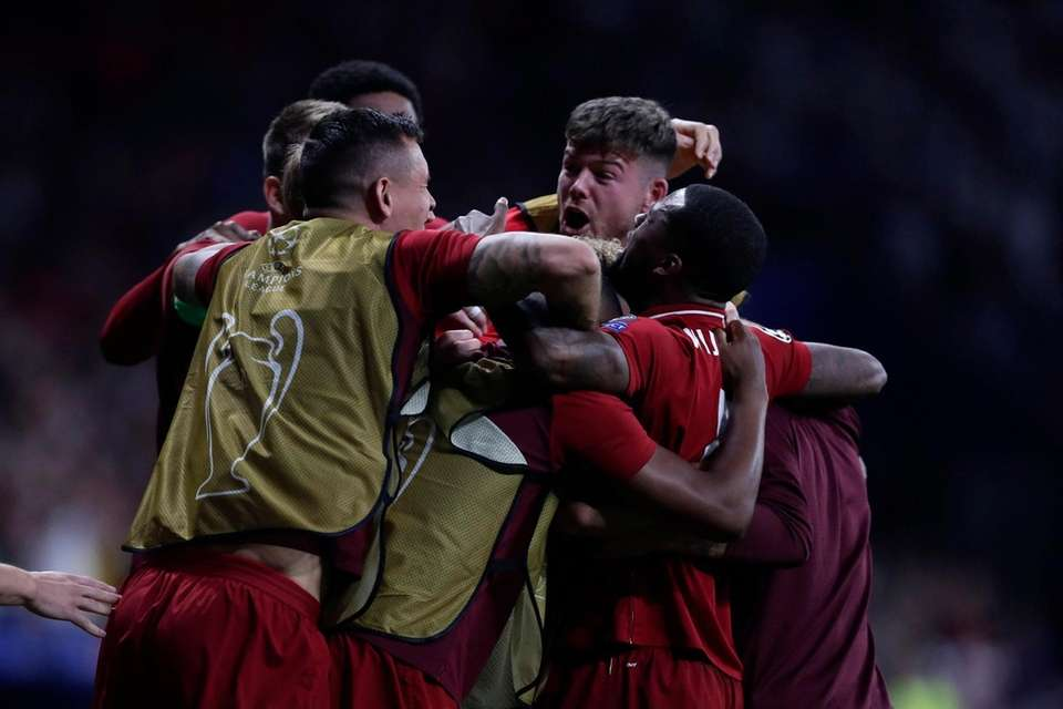 Liverpool players celebrate Divock Origi scoring his side's