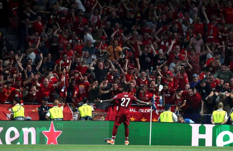 Liverpool's Divock Origi celebrates with his fans after