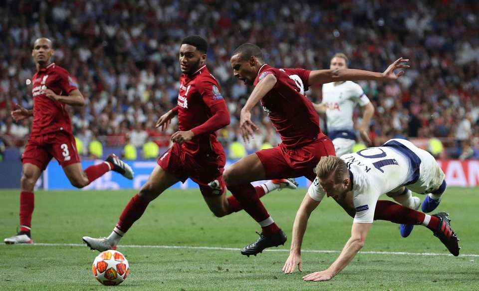 Tottenham's Harry Kane, right, falls over Liverpool's Joel