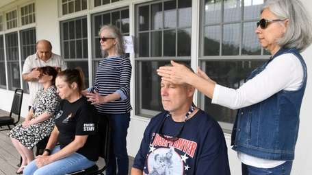 Veterans receive energy treatments and relaxation techniques at