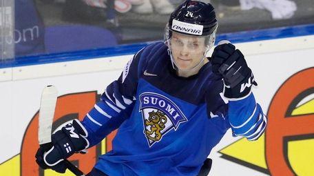 Finland's Kaapo Kakko, up, celebrates with Harri Pesonen,