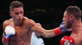 Chris Algieri punches Tommy Coyle during a WBO