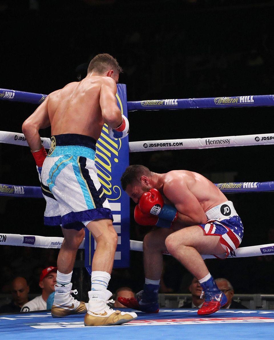 Chris Algieri knocks down Tommy Coyle during a