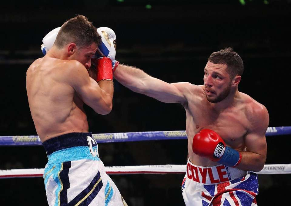 Tommy Coyle punches Chris Algieri during their a