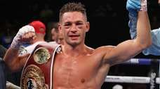 Chris Algieri celebrates defeating Tommy Coyle during a