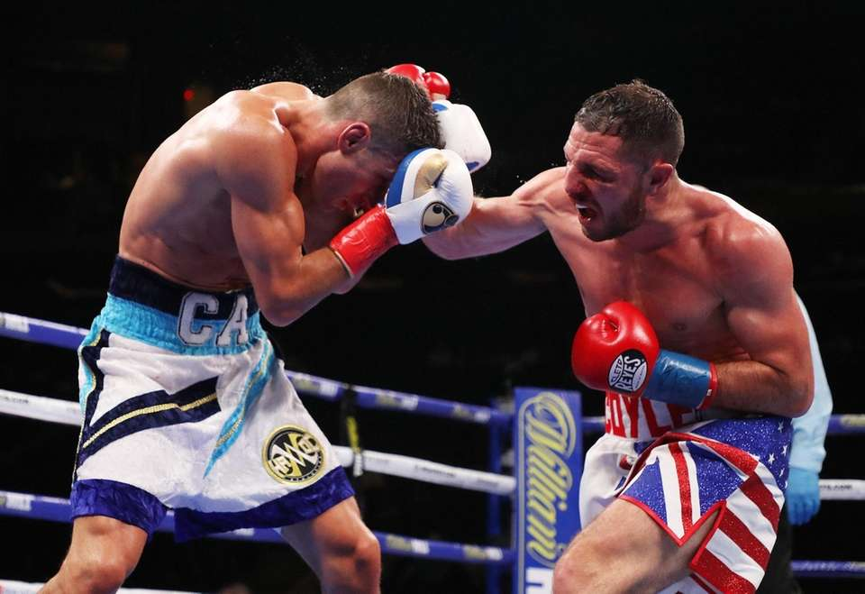 Tommy Coyle punches Chris Algieri during a WBO