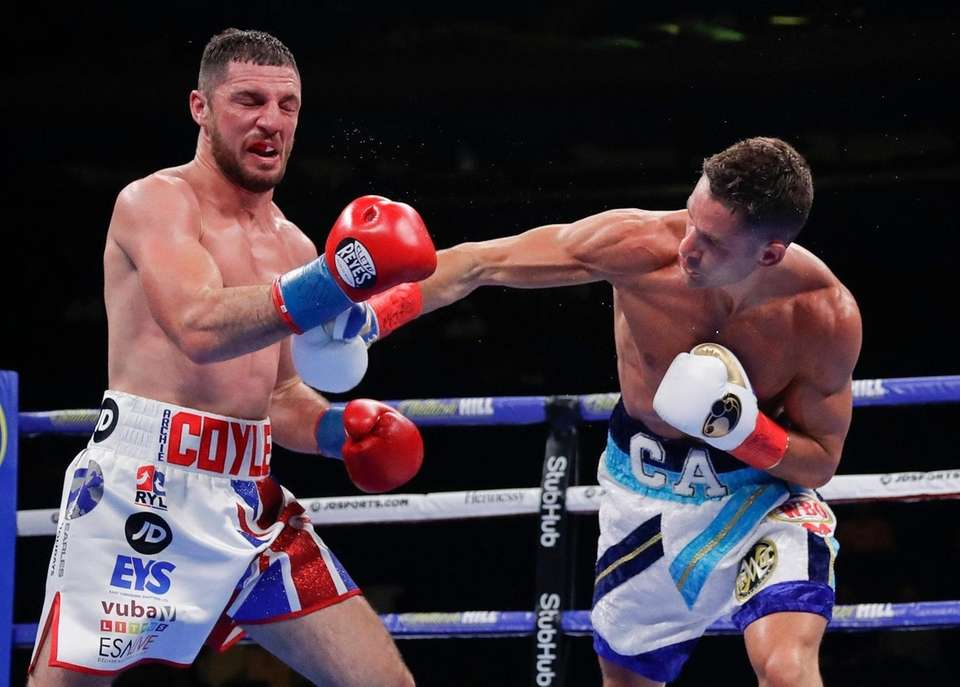 Chris Algieri, right, punches England's Tommy Coyle during