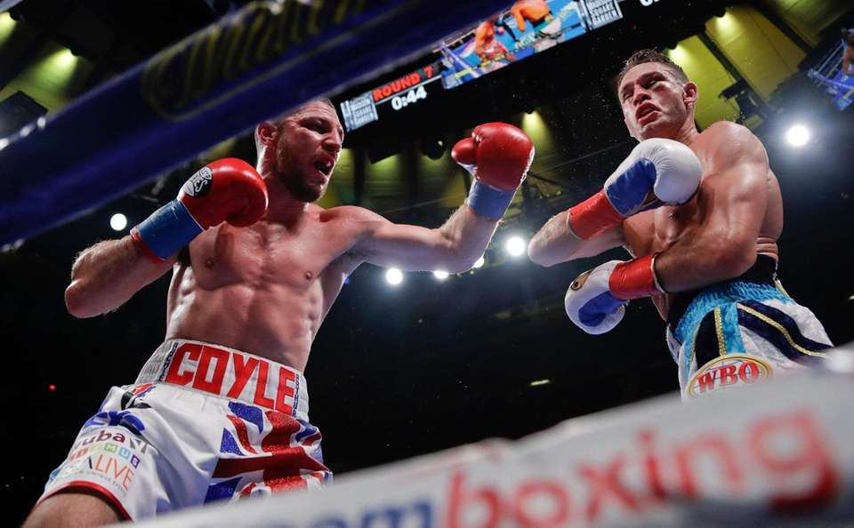 England's Tommy Coyle, left, punches Chris Algieri during