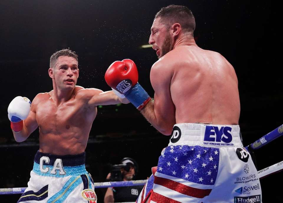 Chris Algieri, left, punches England's Tommy Coyle during