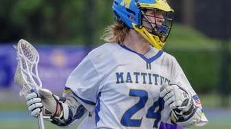 Greg Hauser #24 of Mattituck moves the ball