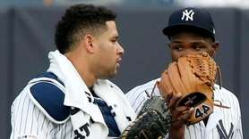 Domingo German #55 and Gary Sanchez #24 of