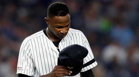 Domingo German of the Yankees reacts on the