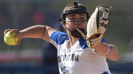 East Meadow's Amy Mallah throws to first base