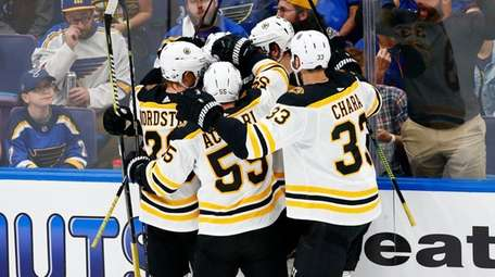 Charlie Coyle of the Bruins is congratulated by