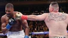 Andy Ruiz, right, punches Anthony Joshua during the