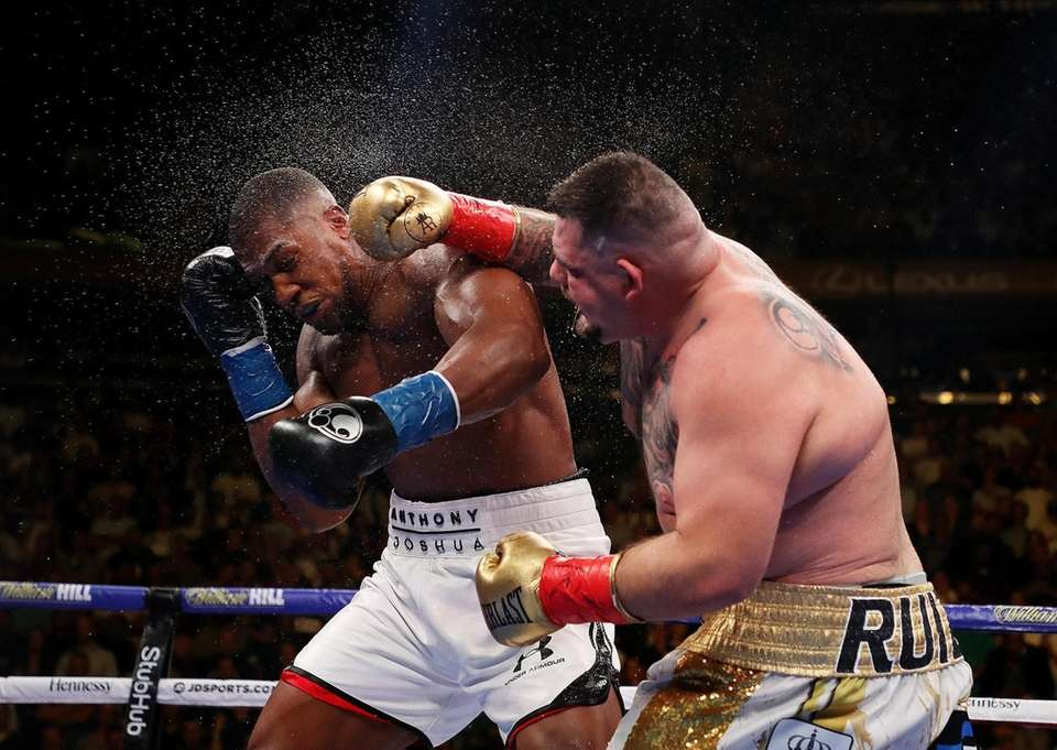 Andy Ruiz Jr. punches Anthony Joshua after their