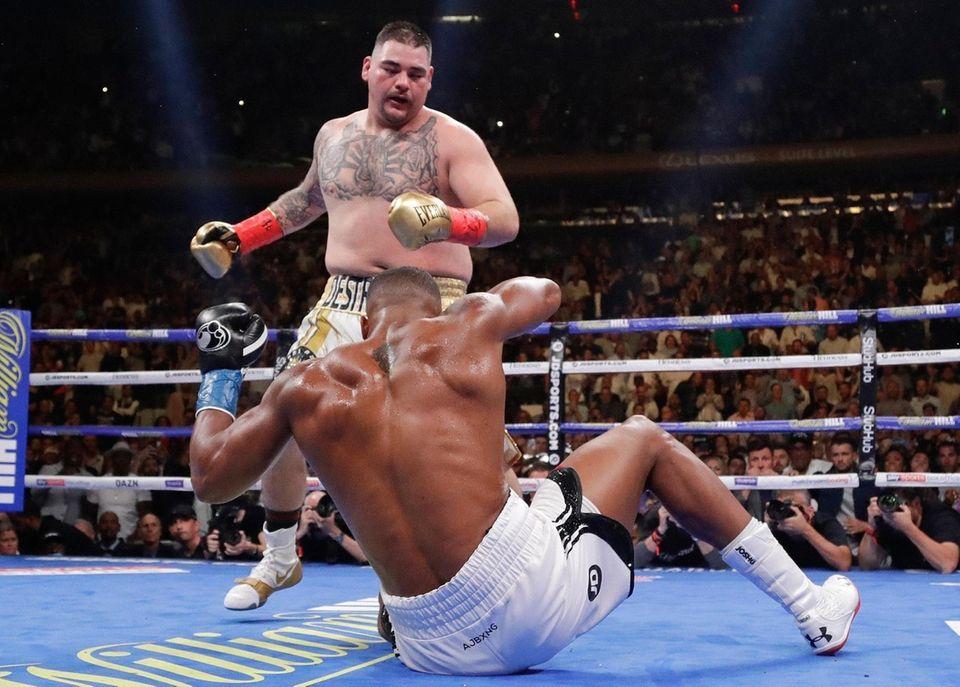 Andy Ruiz knocks down Anthony Joshua during the