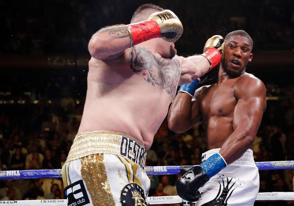 Andy Ruiz, left, punches Anthony Joshua during the