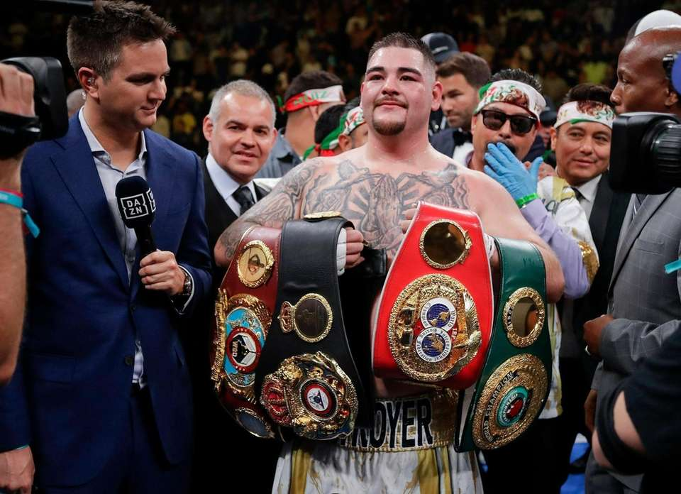 Andy Ruiz poses for photographs after a heavyweight