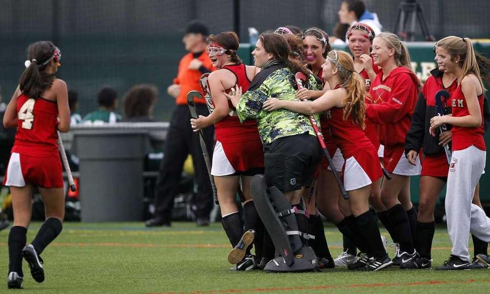 Sachem East players celebrate their victory over Ward