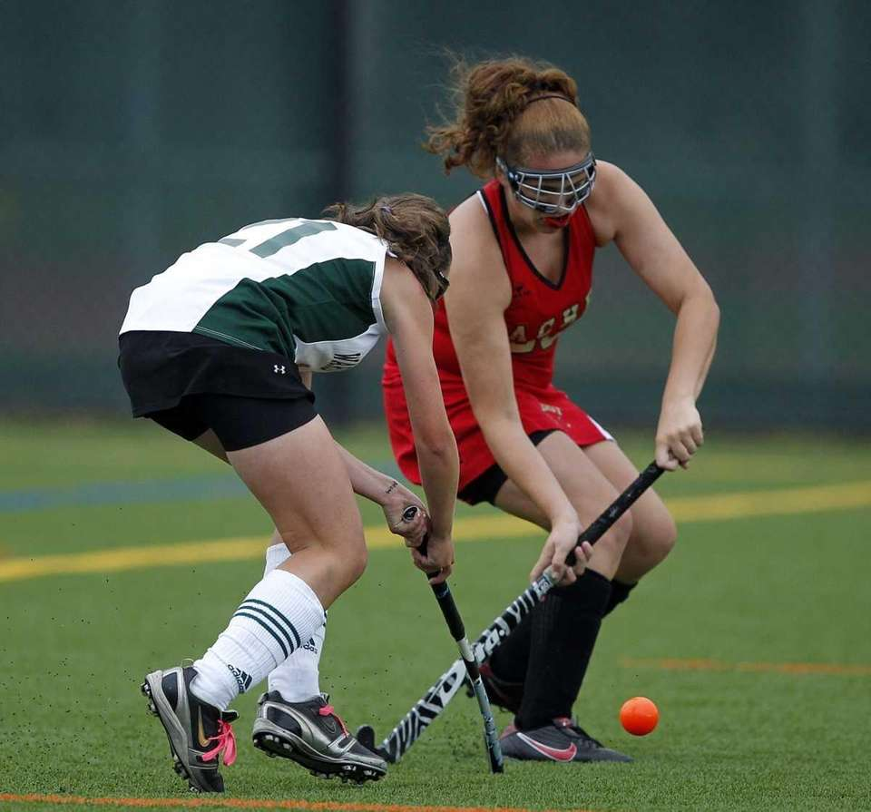 Sachem East's Courtney Hallick (23) wins the duel