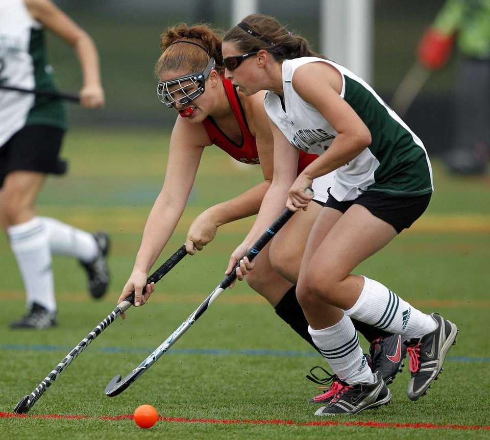 Sachem East's Karen Ryan (34) taps the ball