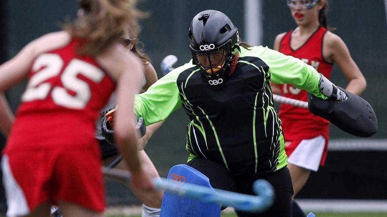 Ward Melville goalie Andre Bongiorno kicks away a