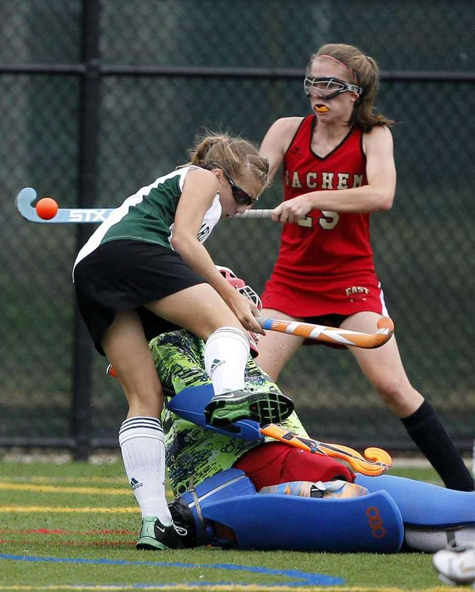 Ward Melville's Kelsey Catalano (1) collides with Sachem