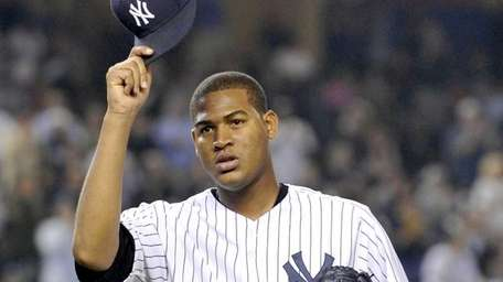 Ivan Nova tips his cap to the cheering