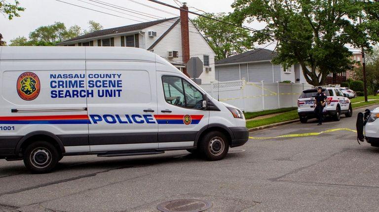 Nassau County police investigate a homicide at a
