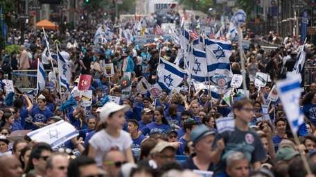 People march in the Celebrate Israel parade on