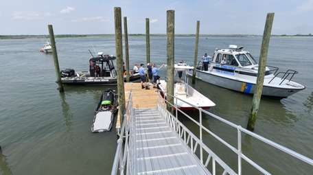 Boats congregate at a new dock for emergency