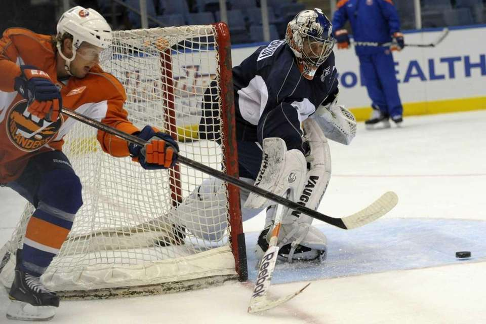 Brian Rolston and goalie Evgeni Nabokov in action