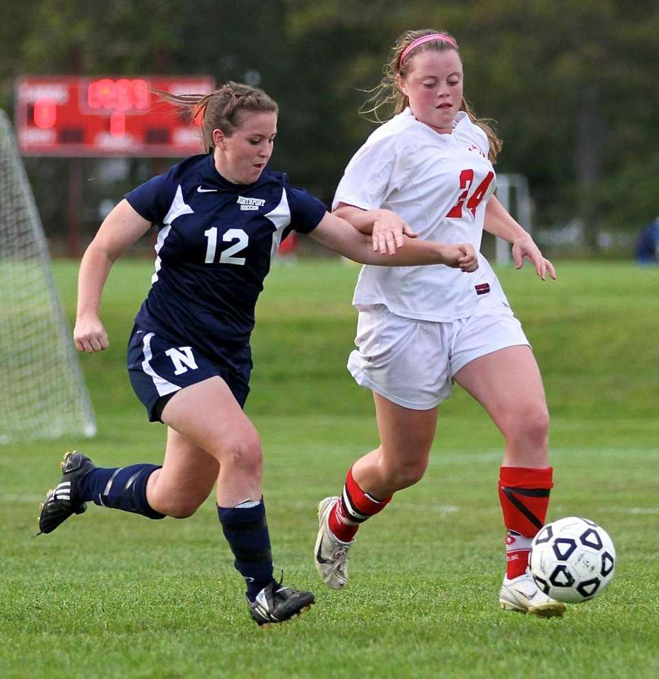 Connetquot's JoJo Murino #24 dribbles the ball as