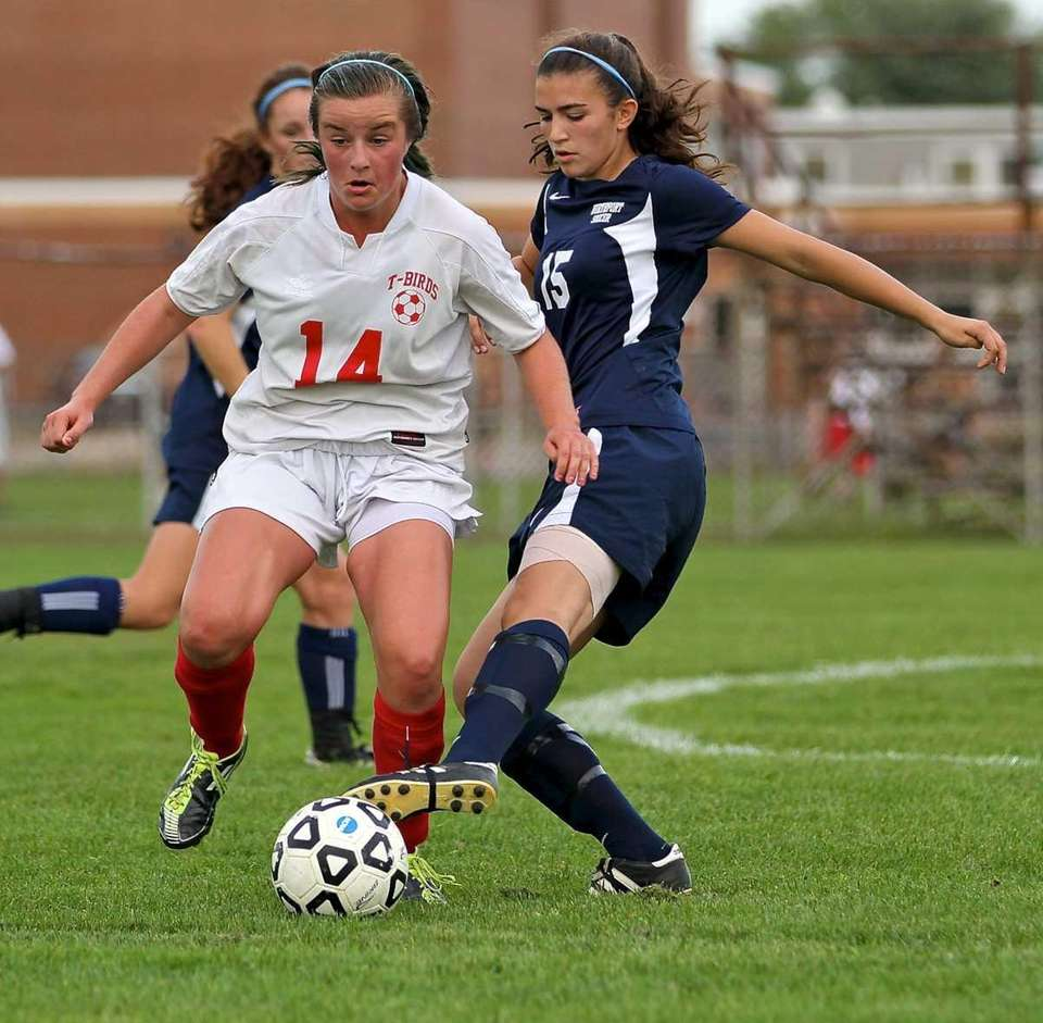 Connetquot's Emma O'Donnell #14 has the ball stripped