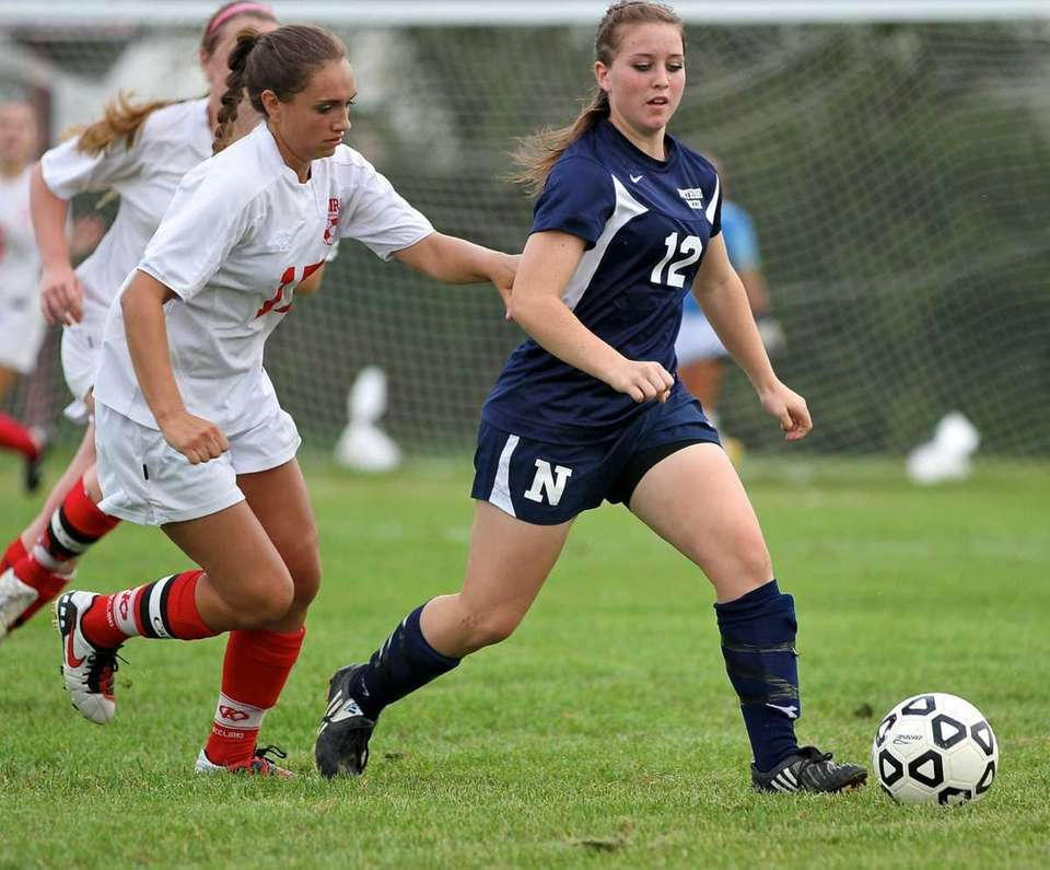 Northport midfield Ashlee Burke #12 goes for the