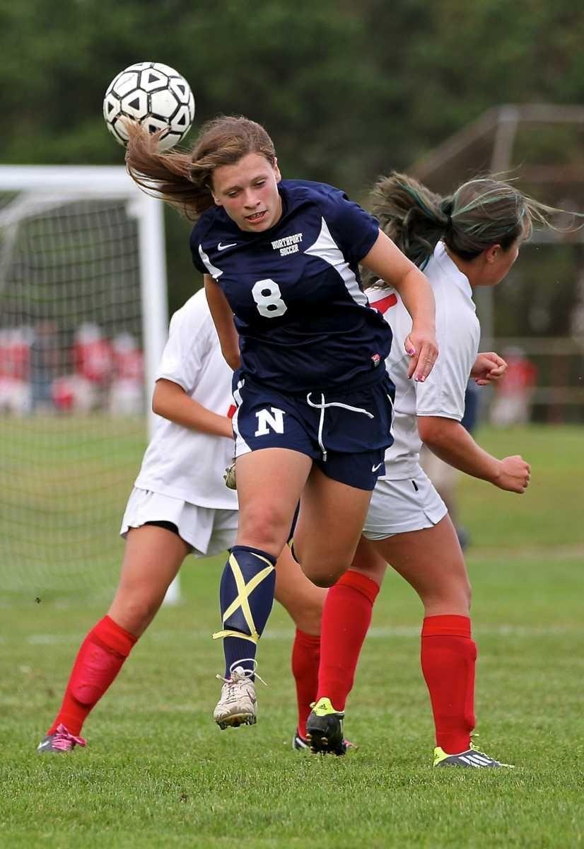 Northport defender Kristin Desmond #8, heads the ball