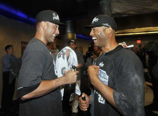 Derek Jeter and Mariano Rivera celebrate after the