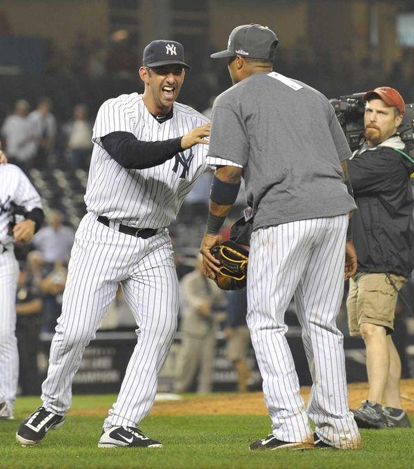 Jorge Posada, who had the game-winning hit, celebrates