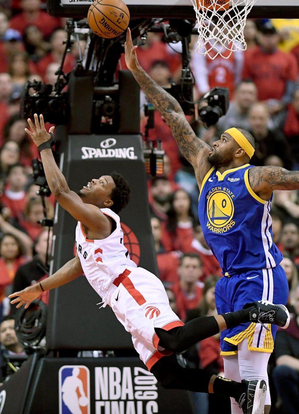 Toronto Raptors guard Kyle Lowry (7) goes down