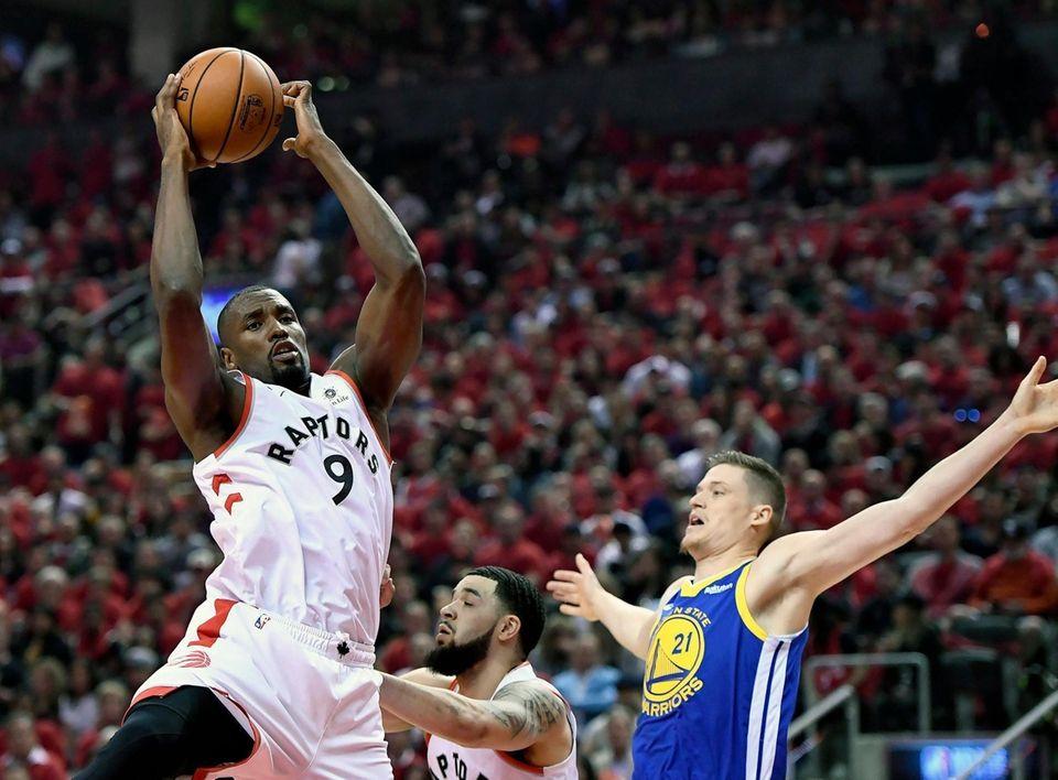 Toronto Raptors center Serge Ibaka (9) drives to