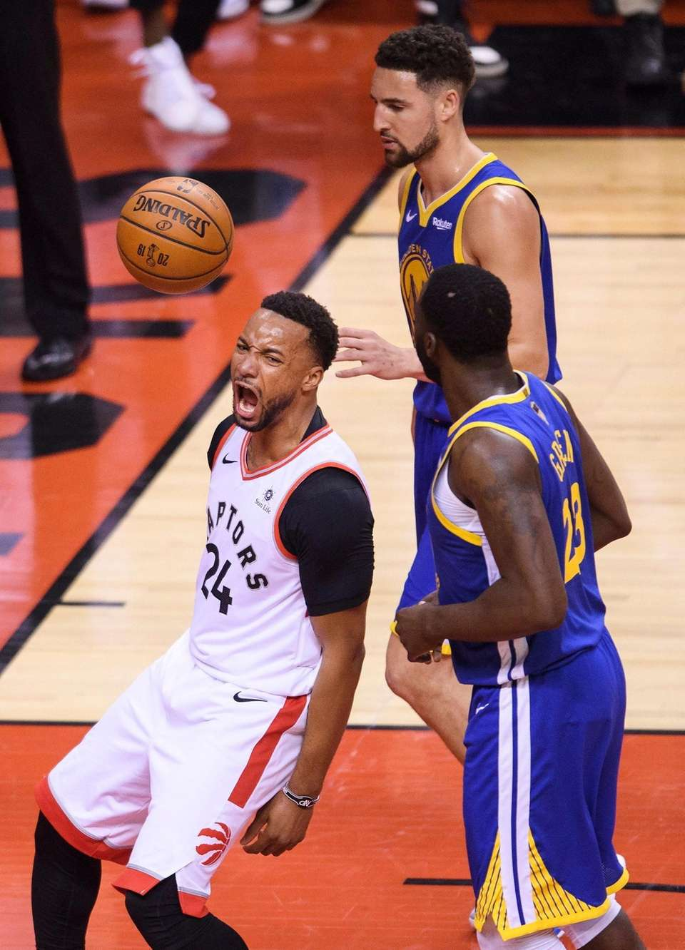Toronto Raptors forward Norman Powell (24) reacts after